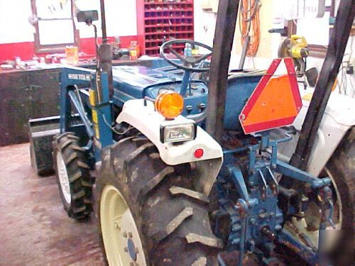 1985 ford 1710 4X4 tractor with 77A loader